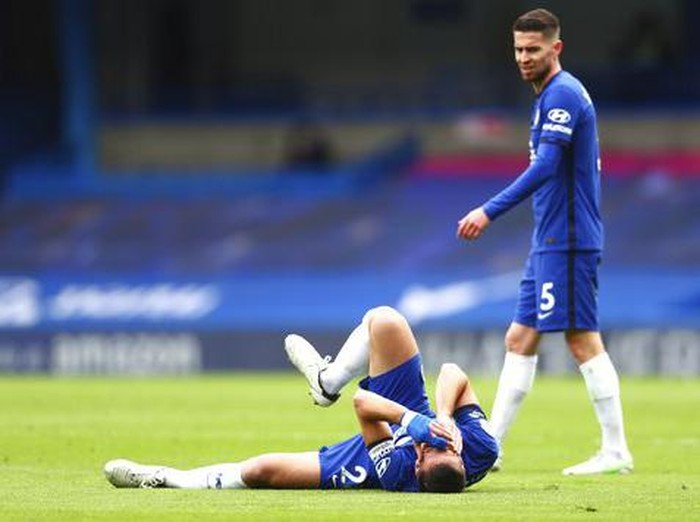 Chelseas Cesar Azpilicueta reacts injured at the ground during the English Premier League soccer match between Chelsea and West Bromwich Albion at Stamford Bridge stadium in London, England, Saturday, April 3, 2021.(Clive Rose/Pool via AP)