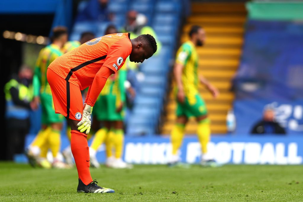 LONDON, ENGLAND - APRIL 3: Edouard Mendy, of Chelsea, appears shot down during the Premier League match between Chelsea and West Bromwich Albion at Stamford Bridge on April 3, 2021 in London, England.  Sports stadiums across the UK remain under strict restrictions due to the coronavirus pandemic, as government social distancing laws ban fans inside venues, causing games to be held behind closed doors.  (Photo by Clive Rose / Getty Images)