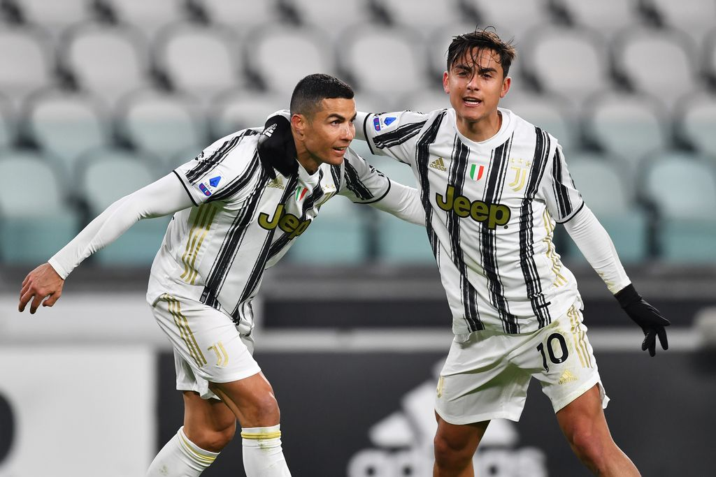 TURIN, ITALY - JANUARY 03: Cristiano Ronaldo of Juventus F.C.  celebrates with teammate Paulo Dybala after scoring their team's first goal during the Serie A match between Juventus and Udinese Calcio at Allianz Stadium on January 03, 2021 in Turin, Italy. Sporting stadiums around Italy remain under strict restrictions due to the Coronavirus Pandemic as Government social distancing laws prohibit fans inside venues resulting in games being played behind closed doors. (Photo by Valerio Pennicino/Getty Images)