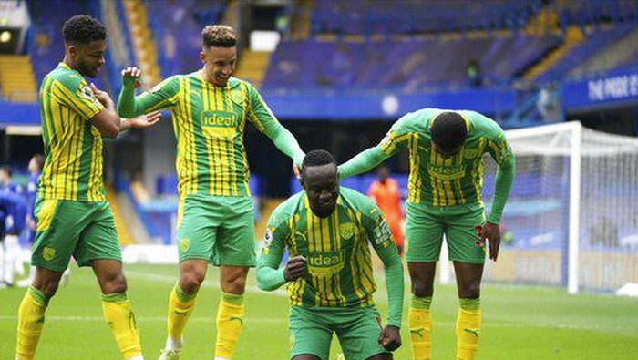 West Bromwich Albions Mbaye Diagne celebrates scoring their fourth goal during the English Premier League soccer match between Chelsea and West Bromwich Albion at Stamford Bridge stadium in London, England, Saturday, April 3, 2021.(John Walton/Pool via AP)