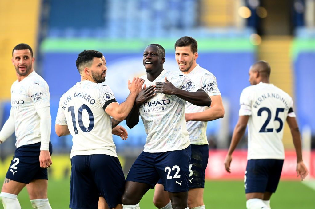 LEICESTER, ENGLAND - APRIL 03: Benjamin Mendy of Manchester City celebrates with team mates Ruben Dias and Sergio Aguero after scoring their side's first goal during the Premier League match between Leicester City and Manchester City at The King Power Stadium on April 03, 2021 in Leicester, England. Sporting stadiums around the UK remain under strict restrictions due to the Coronavirus Pandemic as Government social distancing laws prohibit fans inside venues resulting in games being played behind closed doors. (Photo by Michael Regan/Getty Images)