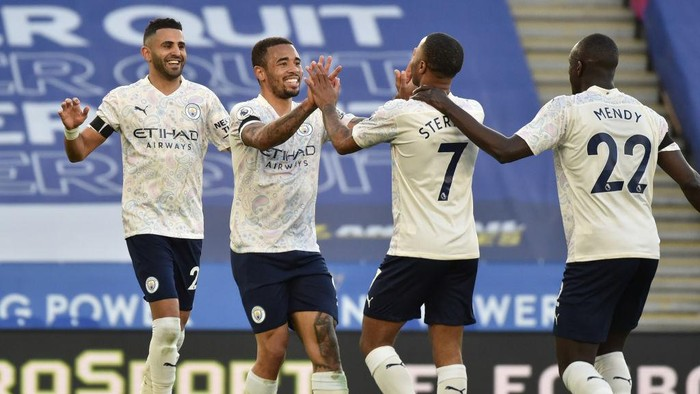 LEICESTER, ENGLAND - APRIL 03: Gabriel Jesus of Manchester City celebrates with teammates Riyad Mahrez, Raheem Sterling and Benjamin Mendy after scoring their teams second goal during the Premier League match between Leicester City and Manchester City at The King Power Stadium on April 03, 2021 in Leicester, England. Sporting stadiums around the UK remain under strict restrictions due to the Coronavirus Pandemic as Government social distancing laws prohibit fans inside venues resulting in games being played behind closed doors. (Photo by Rui Vieira - Pool/Getty Images)