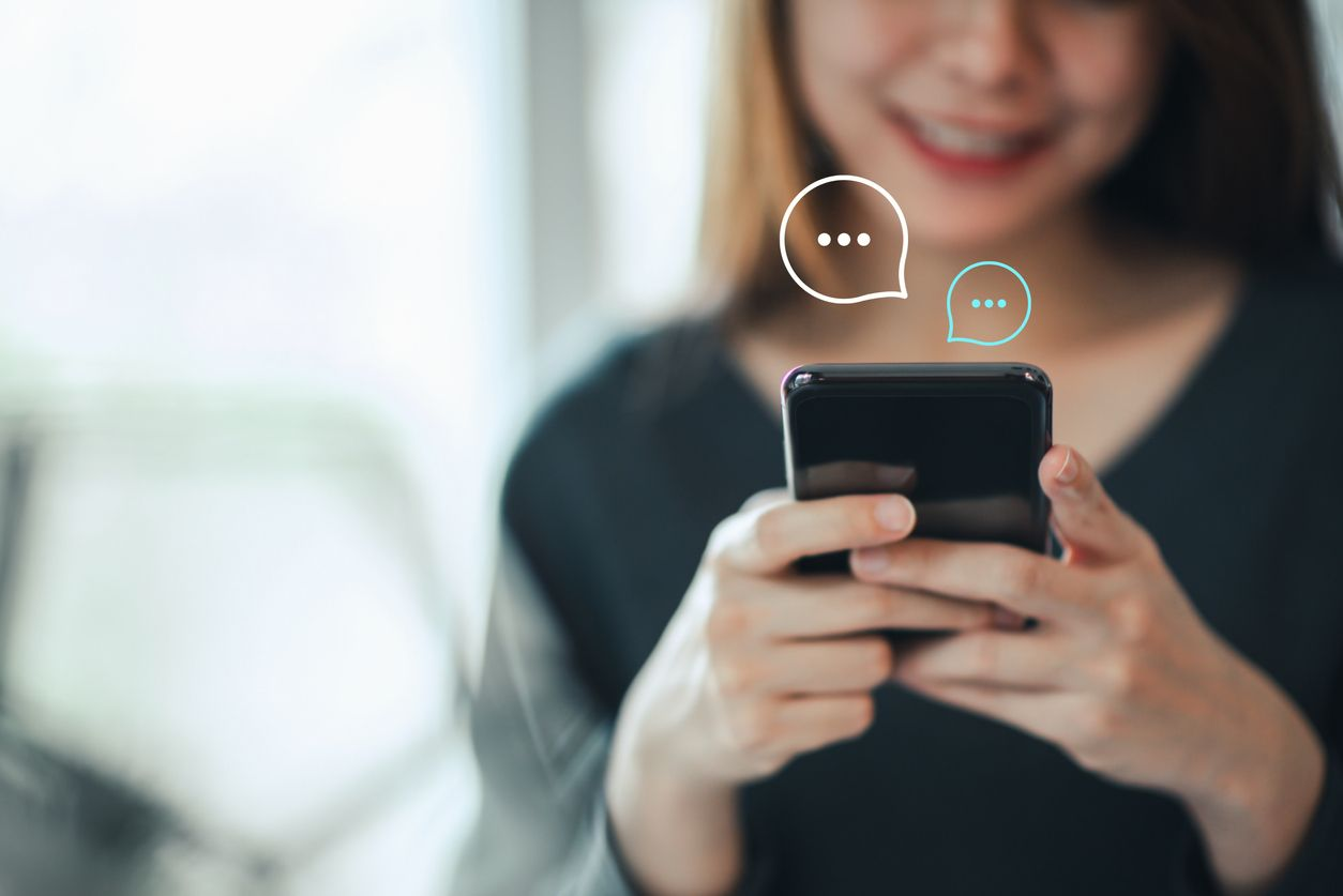 Women's hand typing on mobile smartphone, Live Chat Chatting on application Communication Digital Web and social network Concept. Work from home.
