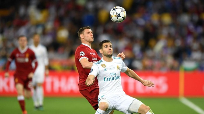 KIEV, UKRAINE - MAY 26:  Nacho Fernandez of Real Madrid is challenged by James Milner of Liverpool during the UEFA Champions League Final between Real Madrid and Liverpool at NSC Olimpiyskiy Stadium on May 26, 2018 in Kiev, Ukraine.  (Photo by Shaun Botterill/Getty Images)