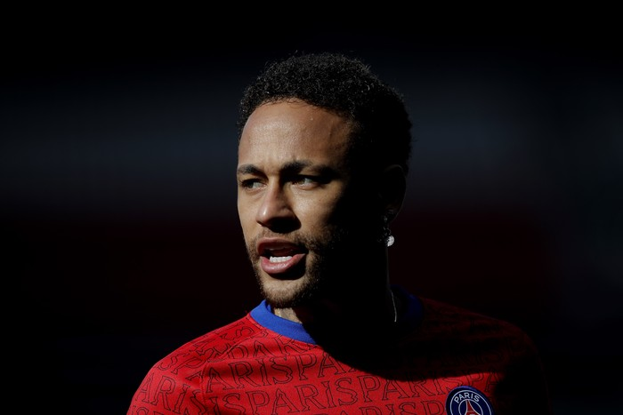PSGs Neymar warms up before the French League One soccer match between Paris Saint Germain and Lille, at the Parc des Princes stadium, in Paris, France, Saturday, April. 3, 2021. (AP Photo/Christophe Ena)