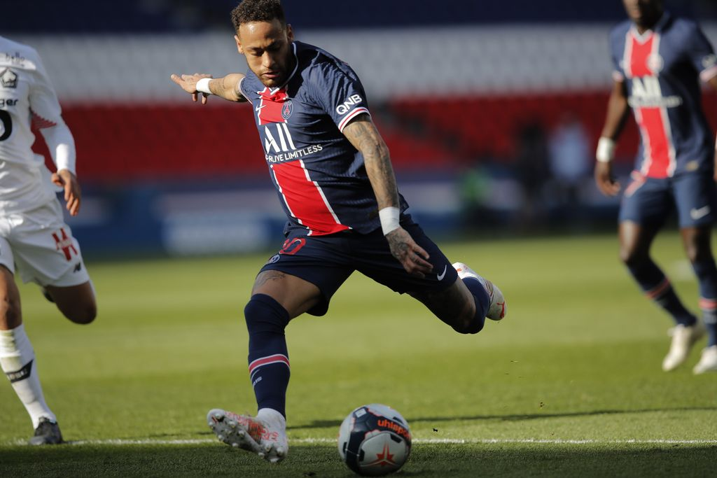 PSG's Neymar warms up before the French League One soccer match between Paris Saint Germain and Lille, at the Parc des Princes stadium, in Paris, France, Saturday, April. 3, 2021. (AP Photo/Christophe Ena)