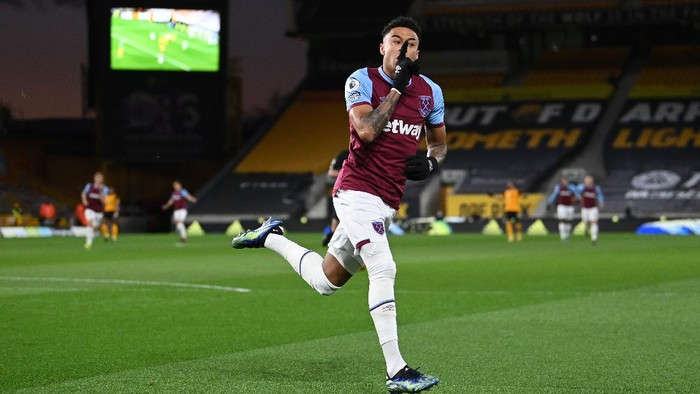WOLVERHAMPTON, ENGLAND - APRIL 05: Jesse Lingard of West Ham United celebrates after scoring their team's first goal during the Premier League match between Wolverhampton Wanderers and West Ham United at Molineux on April 05, 2021 in Wolverhampton, England. Sporting stadiums around the UK remain under strict restrictions due to the Coronavirus Pandemic as Government social distancing laws prohibit fans inside venues resulting in games being played behind closed doors. (Photo by Laurence Griffiths/Getty Images)