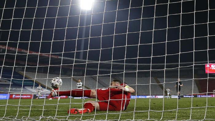 BELGRADE, SERBIA - MARCH 27: Stefan Mitrovic of Serbia clears the ball off the line during the FIFA World Cup 2022 Qatar qualifying match between Serbia and Portugal at FK Crvena Zvezda stadium on March 27, 2021 in Belgrade, Serbia. Sporting stadiums around Serbia remain under strict restrictions due to the Coronavirus Pandemic as Government social distancing laws prohibit fans inside venues resulting in games being played behind closed doors.  (Photo by Srdjan Stevanovic/Getty Images)