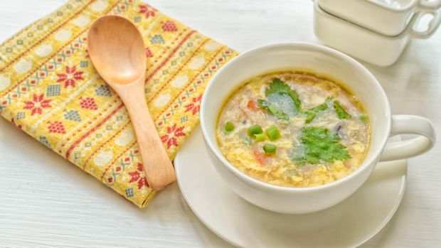 Egg drop soup is a Chinese soup of wispy beaten eggs in boiled chicken broth. Condiments such as black pepper or white pepper, and finely chopped scallions and tofu are also commonly added.
