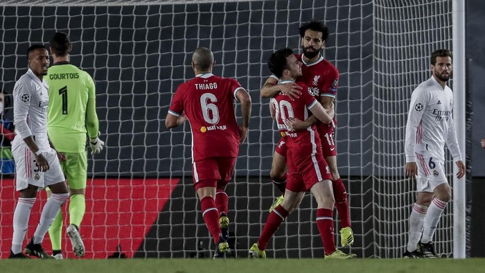 Liverpool players celebrate after scoring their team first goal during the Champions League quarterfinal first leg, soccer match between Real Madrid and Liverpool at the Alfredo di Stefano stadium in Madrid, Spain, Tuesday, April 6, 2021. (AP Photo/Manu Fernandez)