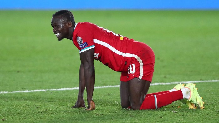 MADRID, SPAIN - APRIL 06: Sadio Mane of Liverpool reacts during the UEFA Champions League Quarter Final match between Real Madrid and Liverpool FC at Estadio Alfredo Di Stefano on April 06, 2021 in Madrid, Spain. Sporting stadiums around Spain remain under strict restrictions due to the Coronavirus Pandemic as Government social distancing laws prohibit fans inside venues resulting in games being played behind closed doors.  (Photo by Fran Santiago/Getty Images)