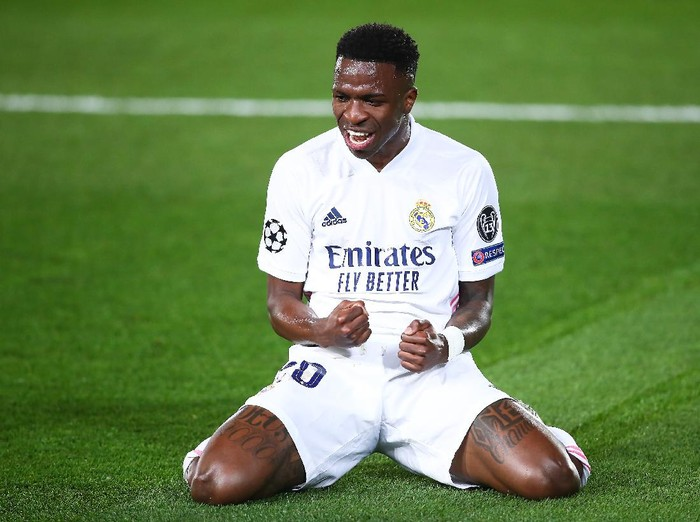 MADRID, SPAIN - APRIL 06: Vinicius Junior of Real Madrid celebrates scoring a goal during the UEFA Champions League Quarter Final match between Real Madrid and Liverpool FC at Estadio Alfredo Di Stefano on April 06, 2021 in Madrid, Spain. (Photo by Fran Santiago/Getty Images)