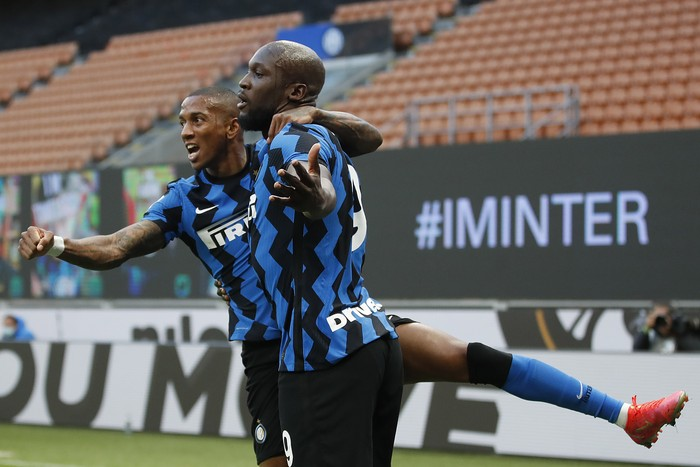 Inter Milans Romelu Lukaku, right, celebrates with his teammate Ashley Young, after scores against Sassuolo during the Serie A soccer match between Inter Milan and Sassuolo at the San Siro Stadium in Milan, Italy, Wednesday, April 7, 2021. (AP Photo/Antonio Calanni)