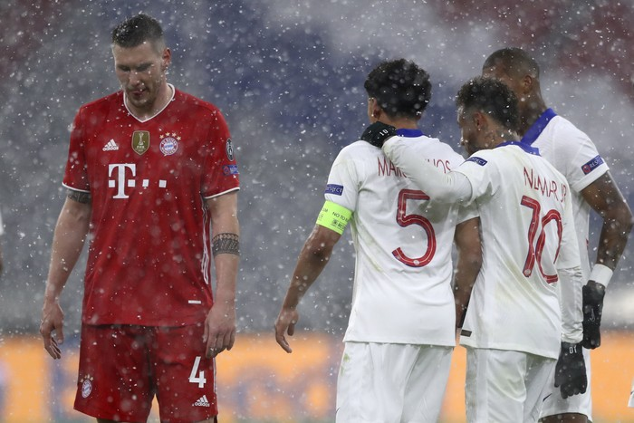 PSGs players celebrate their sides second goal during the Champions League quarterfinal soccer match between Bayern Munich and Paris Saint Germain in Munich, Germany, Wednesday, April 7, 2021. (AP Photo/Matthias Schrader)