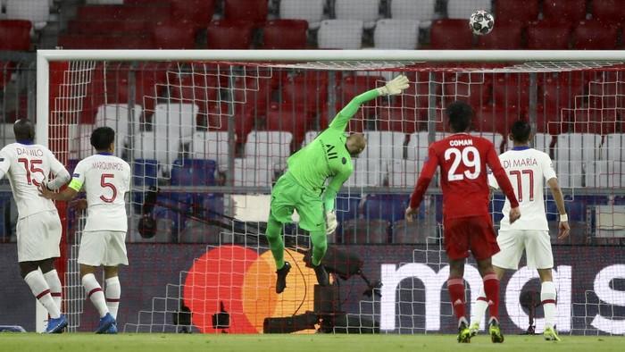 PSGs goalkeeper Keylor Navas makes a save during the Champions League quarterfinal soccer match between Bayern Munich and Paris Saint Germain in Munich, Germany, Wednesday, April 7, 2021. (AP Photo/Matthias Schrader)