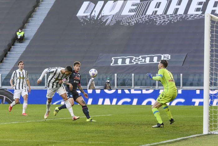 Juventus Cristiano Ronaldo heads the ball during the Italian Serie A soccer match between Juventus and Napoli at the Allianz Stadium in Turin, Italy, Wednesday, April 7, 2021. (Fabio Ferrari/LaPresse via AP)