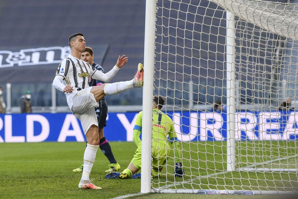 Juventus' Cristiano Ronaldo heads the ball during the Italian Serie A soccer match between Juventus and Napoli at the Allianz Stadium in Turin, Italy, Wednesday, April 7, 2021. (Fabio Ferrari/LaPresse via AP)