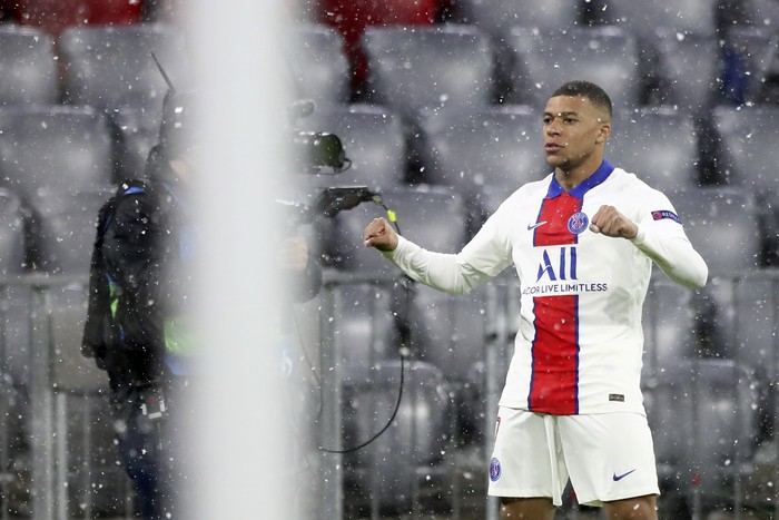 PSGs Kylian Mbappe celebrates after scoring the opening goal of his team during the Champions League quarterfinal soccer match between Bayern Munich and Paris Saint Germain in Munich, Germany, Wednesday, April 7, 2021. (AP Photo/Matthias Schrader)