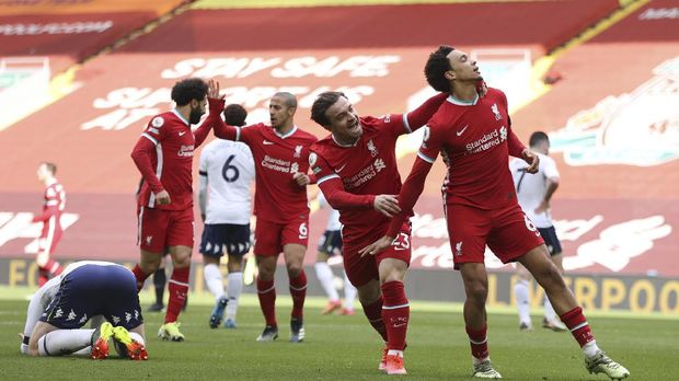 Liverpool's Trent Alexander-Arnold, right, celebrates after scoring his side's second goal during the English Premier League soccer match between Liverpool and Aston Villa at Anfield stadium in Liverpool, England, Saturday, April 10, 2021. (Clive Brunskill/Pool via AP)