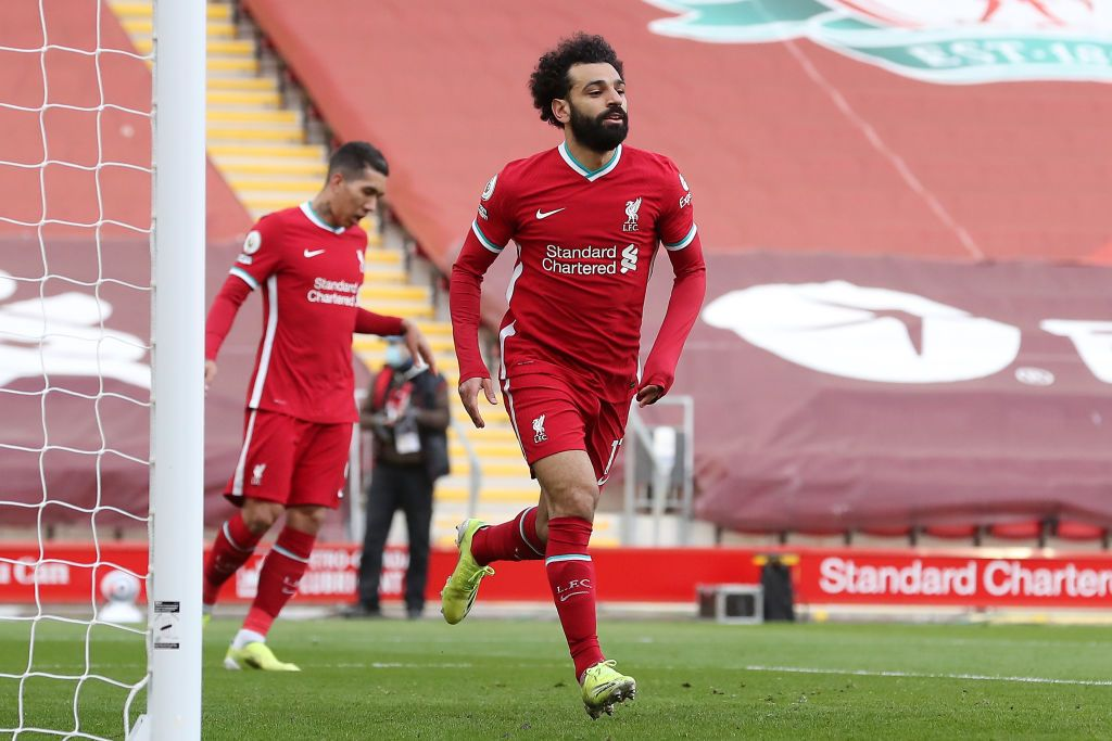 LIVERPOOL, ENGLAND - APRIL 10: Mohamed Salah of Liverpool celebrates after scoring their team's first goal during the Premier League match between Liverpool and Aston Villa at Anfield on April 10, 2021 in Liverpool, England. Sporting stadiums around the UK remain under strict restrictions due to the Coronavirus Pandemic as Government social distancing laws prohibit fans inside venues resulting in games being played behind closed doors.  (Photo by Martin Rickett - Pool/Getty Images)