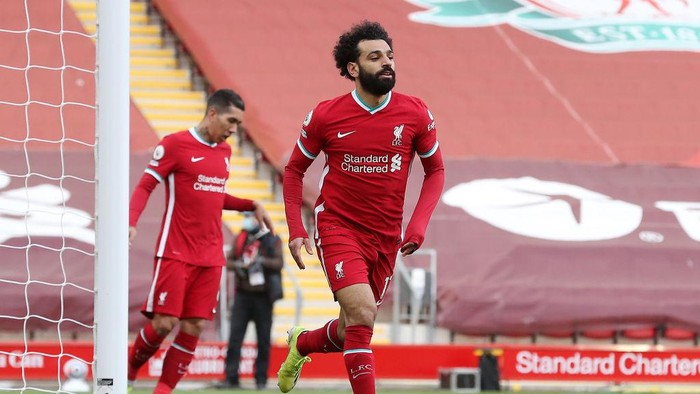 LIVERPOOL, ENGLAND - APRIL 10: Mohamed Salah of Liverpool celebrates after scoring their teams first goal during the Premier League match between Liverpool and Aston Villa at Anfield on April 10, 2021 in Liverpool, England. Sporting stadiums around the UK remain under strict restrictions due to the Coronavirus Pandemic as Government social distancing laws prohibit fans inside venues resulting in games being played behind closed doors.  (Photo by Martin Rickett - Pool/Getty Images)