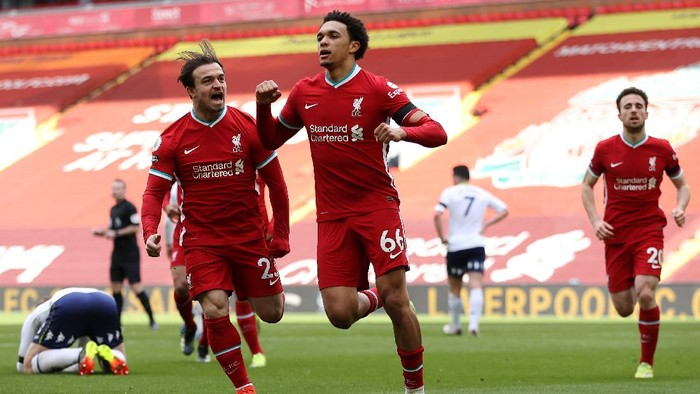 LIVERPOOL, ENGLAND - APRIL 10: Trent Alexander-Arnold of Liverpool celebrates with teammate Xherdan Shaqiri after scoring their teams second goal during the Premier League match between Liverpool and Aston Villa at Anfield on April 10, 2021 in Liverpool, England. Sporting stadiums around the UK remain under strict restrictions due to the Coronavirus Pandemic as Government social distancing laws prohibit fans inside venues resulting in games being played behind closed doors.  (Photo by Clive Brunskill/Getty Images)