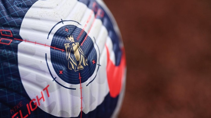 BIRMINGHAM, ENGLAND - FEBRUARY 21: A detailed view of the Premier League trophy on the blue and white Nike Flight Premier League ball prior to the Premier League match between Aston Villa and Leicester City at Villa Park on February 21, 2021 in Birmingham, England. Sporting stadiums around the UK remain under strict restrictions due to the Coronavirus Pandemic as Government social distancing laws prohibit fans inside venues resulting in games being played behind closed doors. (Photo by Michael Regan/Getty Images)
