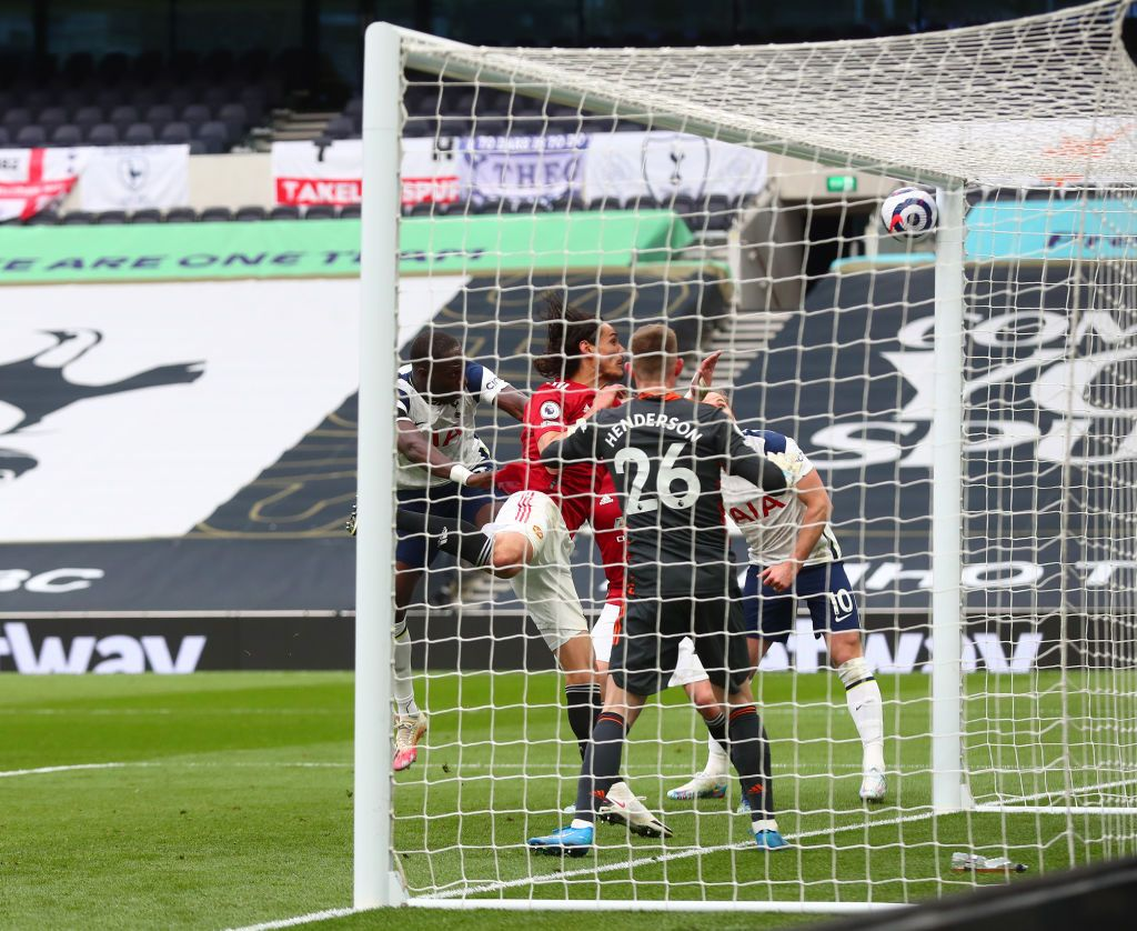 LONDON, ENGLAND - APRIL 11: Edinson Cavani of Manchester United scores their side's second goal during the Premier League match between Tottenham Hotspur and Manchester United at Tottenham Hotspur Stadium on April 11, 2021 in London, England. Sporting stadiums around the UK remain under strict restrictions due to the Coronavirus Pandemic as Government social distancing laws prohibit fans inside venues resulting in games being played behind closed doors. (Photo by Adrian Dennis - Pool/Getty Images)
