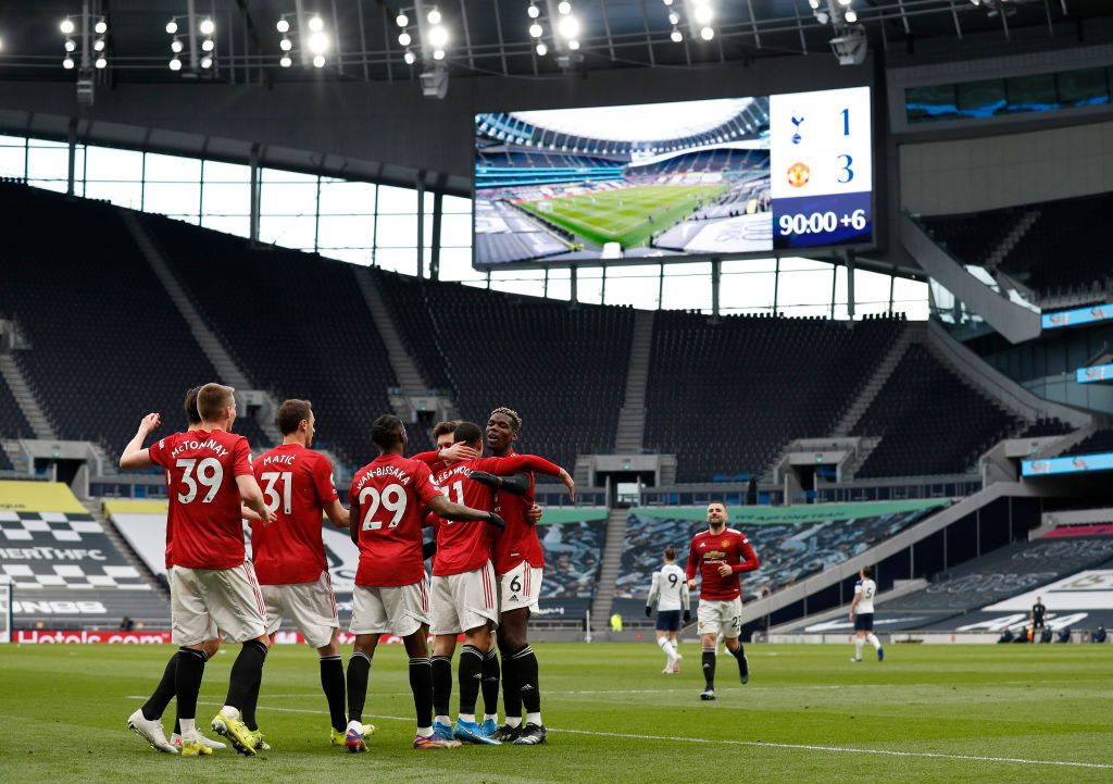 LONDON, ENGLAND - APRIL 11: Mason Greenwood of Manchester United celebrates with Scott McTominay and Harry Maguire after scoring their side's third goal during the Premier League match between Tottenham Hotspur and Manchester United at Tottenham Hotspur Stadium on April 11, 2021 in London, England. Sporting stadiums around the UK remain under strict restrictions due to the Coronavirus Pandemic as Government social distancing laws prohibit fans inside venues resulting in games being played behind closed doors. (Photo by Adrian Dennis - Pool/Getty Images)