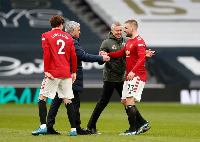LONDON, ENGLAND - APRIL 11: Jose Mourinho, Manager of Tottenham Hotspur interacts with Luke Shaw of Manchester United after the Premier League match between Tottenham Hotspur and Manchester United at Tottenham Hotspur Stadium on April 11, 2021 in London, England. Sporting stadiums around the UK remain under strict restrictions due to the Coronavirus Pandemic as Government social distancing laws prohibit fans inside venues resulting in games being played behind closed doors. (Photo by Matthew Childs - Pool/Getty Images)