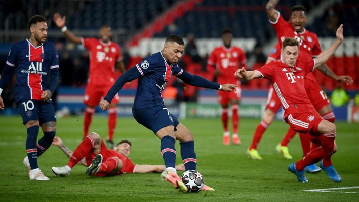 PARIS, FRANCE - APRIL 13: Kylian Mbappe of Paris Saint-Germain breaks away to shpoo during the UEFA Champions League Quarter Final Second Leg match between Paris Saint-Germain and FC Bayern Munich at Parc des Princes on April 13, 2021 in Paris, France. Sporting stadiums around France remain under strict restrictions due to the Coronavirus Pandemic as Government social distancing laws prohibit fans inside venues resulting in games being played behind closed doors. (Photo by Matthias Hangst/Getty Images)