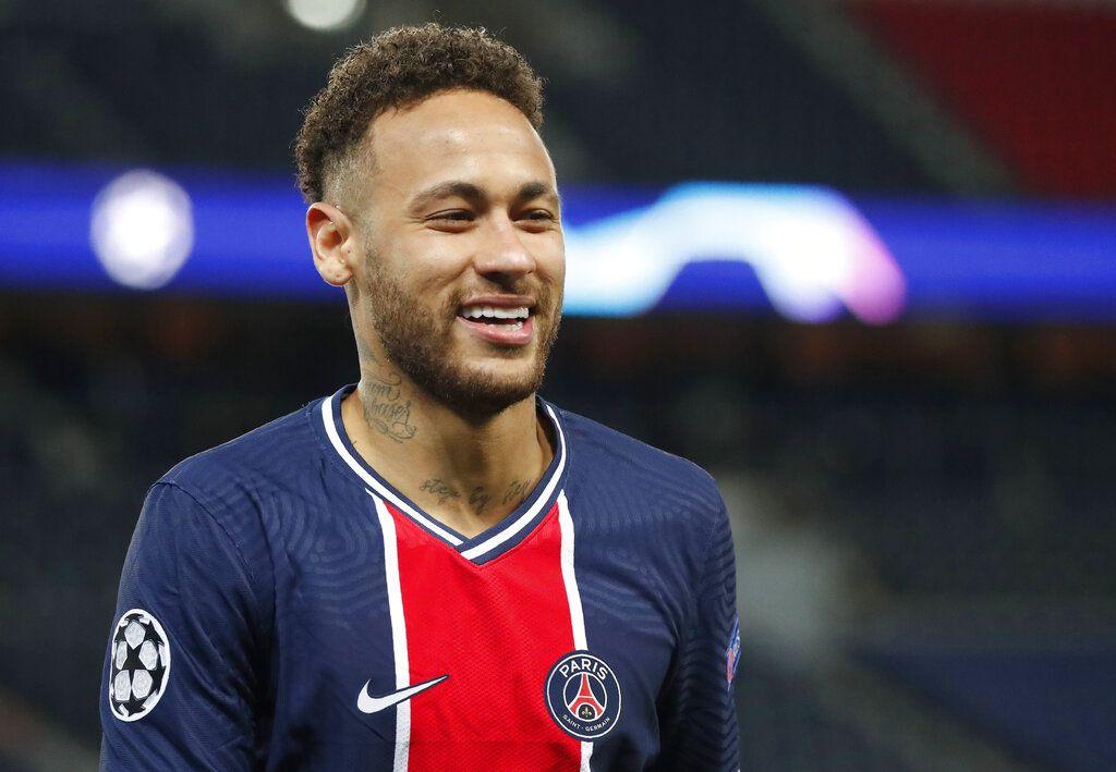 PSG's Neymar smiles during the Champions League, second leg, quarterfinal soccer match between Paris Saint Germain and Bayern Munich at the Parc des Princes stadium, in Paris, France, Tuesday, April 13, 2021. (AP Photo/Francois Mori)