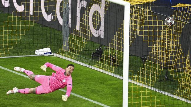 Manchester City's goalkeeper Ederson fails to save a shot by Dortmund's Jude Bellingham during the Champions League quarterfinal second leg soccer match between Borussia Dortmund and Manchester City at the Signal Iduna Park stadium in Dortmund, Germany, Wednesday, April 14, 2021. (Federico Gambarini/Pool via AP)