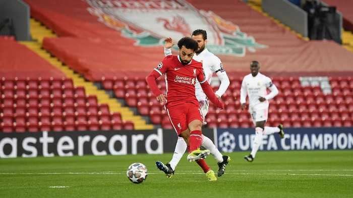 LIVERPOOL, ENGLAND - APRIL 14: Mohamed Salah of Liverpool shoots during the UEFA Champions League Quarter Final Second Leg match between Liverpool FC and Real Madrid at Anfield on April 14, 2021 in Liverpool, England. Sporting stadiums around the UK remain under strict restrictions due to the Coronavirus Pandemic as Government social distancing laws prohibit fans inside venues resulting in games being played behind closed doors. (Photo by Michael Regan/Getty Images)