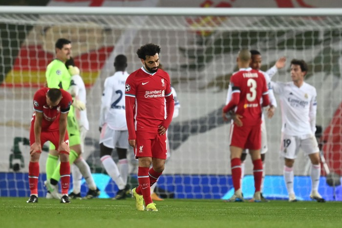 LIVERPOOL, ENGLAND - APRIL 14: Mohamed Salah of Liverpool looks dejected following the UEFA Champions League Quarter Final Second Leg match between Liverpool FC and Real Madrid at Anfield on April 14, 2021 in Liverpool, England. Sporting stadiums around the UK remain under strict restrictions due to the Coronavirus Pandemic as Government social distancing laws prohibit fans inside venues resulting in games being played behind closed doors. (Photo by Michael Regan/Getty Images)