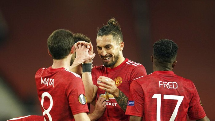 Manchester players celebrate after the Europa League, quarterfinal, second leg soccer match between Manchester United and Granada at the Old Trafford stadium, in Manchester, Thursday, April 15, 2021. (AP Photo/Dave Thompson)