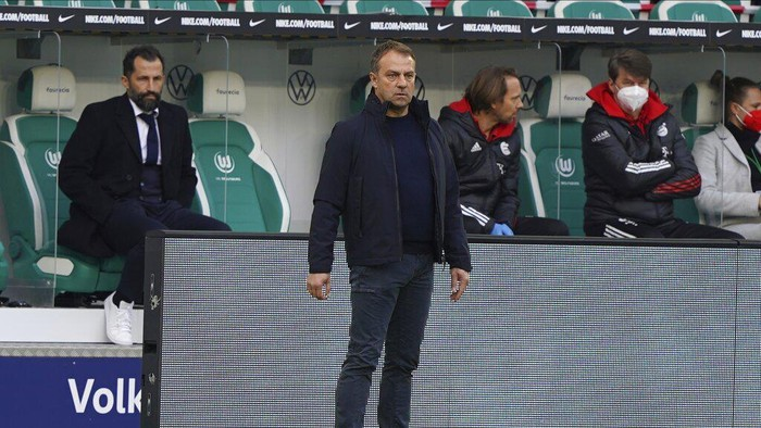 Bayerns head coach Hans-Dieter Flick looks on during the German Bundesliga soccer match between VfL Wolfsburg and FC Bayern Munich in Wolfsburg, Germany, Saturday, April 17, 2021. (AP Photo/Michael Sohn)