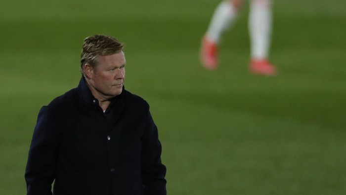 Barcelonas head coach Ronald Koeman follows the action from the side line during the Spanish La Liga soccer match between Real Madrid and FC Barcelona at the Alfredo di Stefano stadium in Madrid, Spain, Saturday, April 10, 2021. (AP Photo/Manu Fernandez)