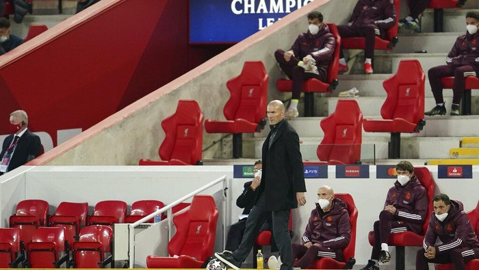 Real Madrids head coach Zinedine Zidane gestures during a Champions League quarter final second leg soccer match between Liverpool and Real Madrid at Anfield stadium in Liverpool, England, Wednesday, April 14, 2021. (AP Photo/Jon Super)