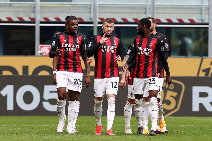 MILAN, ITALY - APRIL 18: Ante Rebic of A.C. Milan  celebrates with teammates after scoring their teams first goal  during the Serie A match between AC Milan  and Genoa CFC at Stadio Giuseppe Meazza on April 18, 2021 in Milan, Italy. Sporting stadiums around Italy remain under strict restrictions due to the Coronavirus Pandemic as Government social distancing laws prohibit fans inside venues resulting in games being played behind closed doors. (Photo by Marco Luzzani/Getty Images)