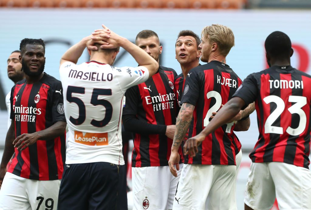MILAN, ITALY - APRIL 18: Ante Rebic of A.C. Milan  celebrates with teammates after scoring their team's first goal  during the Serie A match between AC Milan  and Genoa CFC at Stadio Giuseppe Meazza on April 18, 2021 in Milan, Italy. Sporting stadiums around Italy remain under strict restrictions due to the Coronavirus Pandemic as Government social distancing laws prohibit fans inside venues resulting in games being played behind closed doors. (Photo by Marco Luzzani/Getty Images)