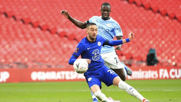 Chelseas Hakim Ziyech, bottom, scores his sides opening goal during the English FA Cup semifinal soccer match between Chelsea and Manchester City at Wembley Stadium in London, England, Saturday, April 17, 2021. (Adam Davy, Pool via AP)