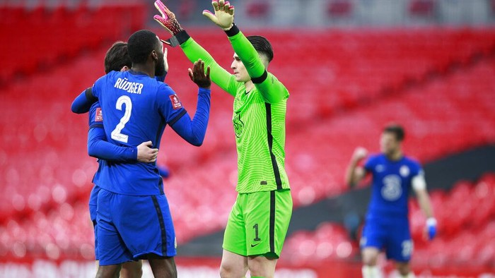 Chelseas goalkeeper Kepa Arrizabalaga, right, celebrates with his teammates after winning the English FA Cup semifinal soccer match between Chelsea and Manchester City at Wembley Stadium in London, England, Saturday, April 17, 2021. (AP Photo/Ian Walton, Pool)