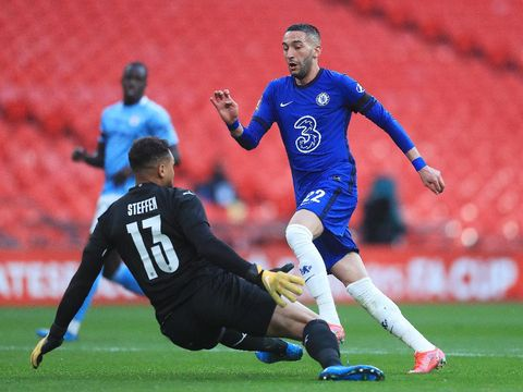 LONDON, ENGLAND - APRIL 17: Zack Steffen of Manchester City saves from Hakim Ziyech of Chelsea during the Semi Final of the Emirates FA Cup match between Manchester City and Chelsea FC at Wembley Stadium on April 17, 2021 in London, England. Sporting stadiums around the UK remain under strict restrictions due to the Coronavirus Pandemic as Government social distancing laws prohibit fans inside venues resulting in games being played behind closed doors.  (Photo by Adam Davy - Pool/Getty Images)