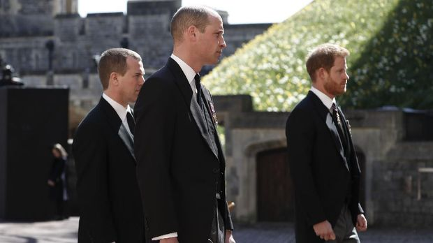 Britain's Prince Harry, right, Prince William, Peter Phillips, left, follow the coffin in a ceremonial procession for the funeral of Britain's Prince Philip inside Windsor Castle in Windsor, England Saturday April 17, 2021. Prince Philip died April 9 at the age of 99 after 73 years of marriage to Britain's Queen Elizabeth II. (Alastair Grant/Pool via AP)