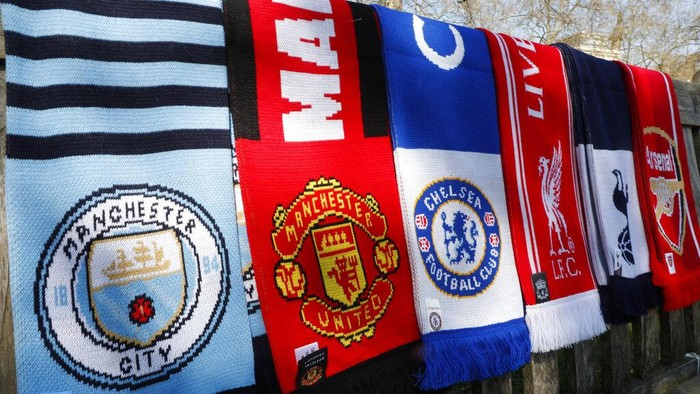 A selection of scarves of the English soccer Premier League teams who are reported to be part of a proposed European Super League, laid out and photographed, in London, Monday, April 19, 2021.  The 12 European clubs planning to start a breakaway Super League have told the leaders of FIFA and UEFA that they have begun legal action aimed at fending off threats to block the competition. (AP Photo/Alastair Grant)