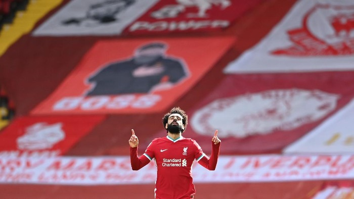 LIVERPOOL, ENGLAND - APRIL 10: Mohamed Salah of Liverpool celebrates after scoring their teams first goal during the Premier League match between Liverpool and Aston Villa at Anfield on April 10, 2021 in Liverpool, England. Sporting stadiums around the UK remain under strict restrictions due to the Coronavirus Pandemic as Government social distancing laws prohibit fans inside venues resulting in games being played behind closed doors.  (Photo by Laurence Griffiths/Getty Images)