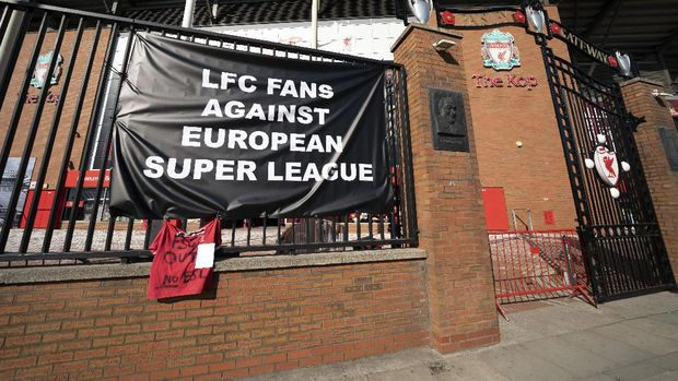 Banners are seen outside Liverpool's Anfield Stadium protesting the formation of the European Super League, Liverpool, England, Monday, April 19, 2021. Players at the 12 clubs setting up their own Super League could be banned from this year's European Championship and next year's World Cup, UEFA President Aleksander Ceferin said Monday.
