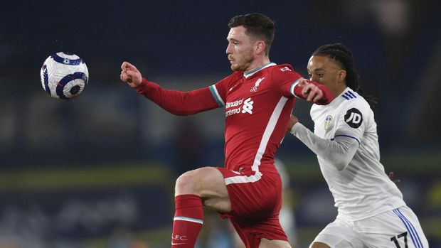 Liverpool's Andrew Robertson, left, is challenged by Leeds United's Helder Costa during the English Premier League soccer match between Leeds United and Liverpool at the Elland Road stadium in Leeds, England, Monday, April 19, 2021. (Paul Ellis/Pool via AP)