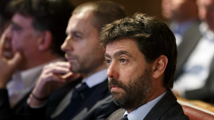 FILE - In this Monday, Dec. 17, 2018 filer, UEFA president Aleksander Ceferin, center, and the Chairman of the European Club Association, ECA, Italys Andrea Agnelli, right, attend the drawing of the matches for the Champions League 2018/19 Round of 16, at the UEFA headquarters in Nyon, Switzerland. The 12 European clubs planning to start a breakaway Super League have told the leaders of FIFA and UEFA that they have begun legal action aimed at fending off threats to block the competition. A letter has been sent by the group of English, Spanish and Italian clubs to FIFA President Gianni Infantino and UEFA counterpart Aleksander Ceferin saying the Super League has already been underwritten by a grant of $5.5 billion from a financial institution. (Salvatore Di Nolfi/Keystone via AP)